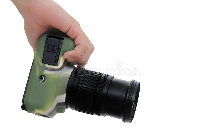 Prawa ręka trzyma kamery DSLR odzieży krzemu kamuflaż zdjęcie royalty free