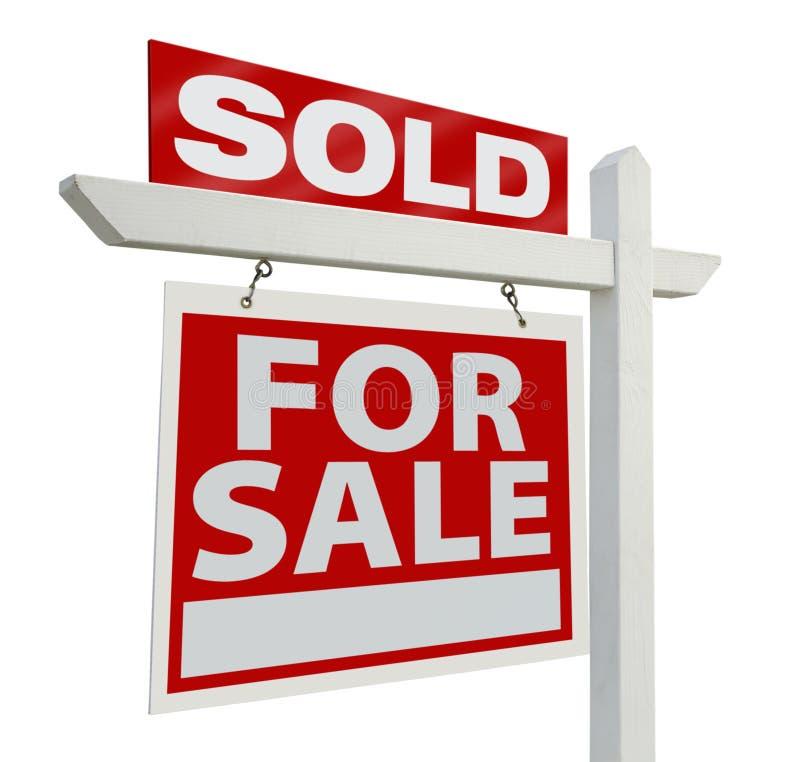 prawdziwy znak sprzedanych nieruchomości fotografia stock