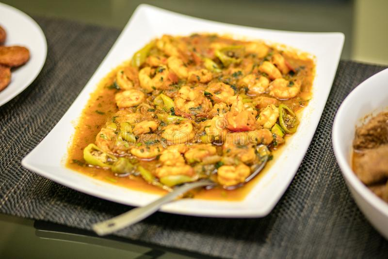 Prawn curry served on a plate royalty free stock image