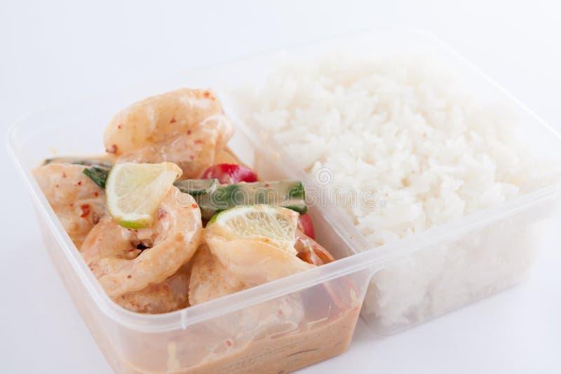 Thai take away food, prawn lemon sauce with rice. Prawn with lemon sauce from Thai cuisine in take away box with rice stock image