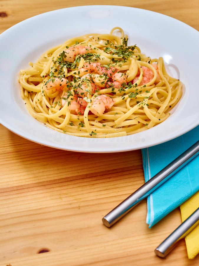 Prawn linguine pasta with basil royalty free stock photo