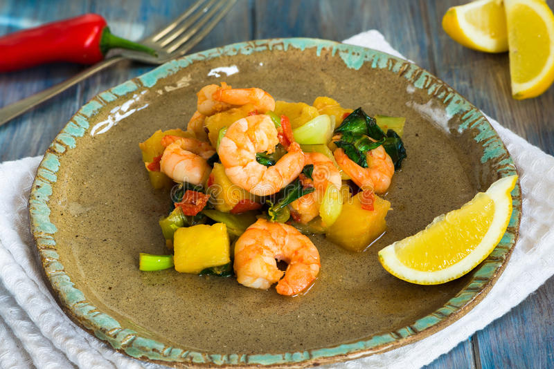 Prawn and pineapple stir fry. With pak choi and chili sauce stock images