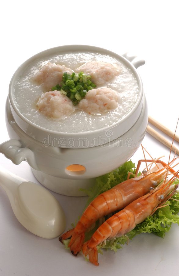 Prawn porridge. Porridge with prawn balls in a pot royalty free stock photo