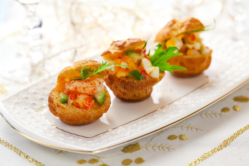 Prawn salad in mini-brioche for holiday royalty free stock images