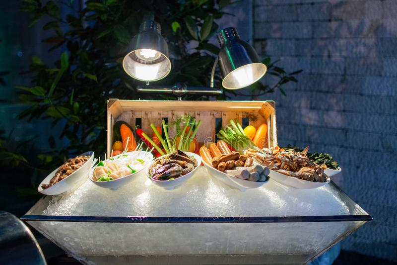 Prawn Skewer, Blue Crab, Sausage, Marinated fish, Brochette for Grill Pit. Prawn skewer, blue crab, chicken sausage, beef frankfurter, marinated emerald fish stock photos