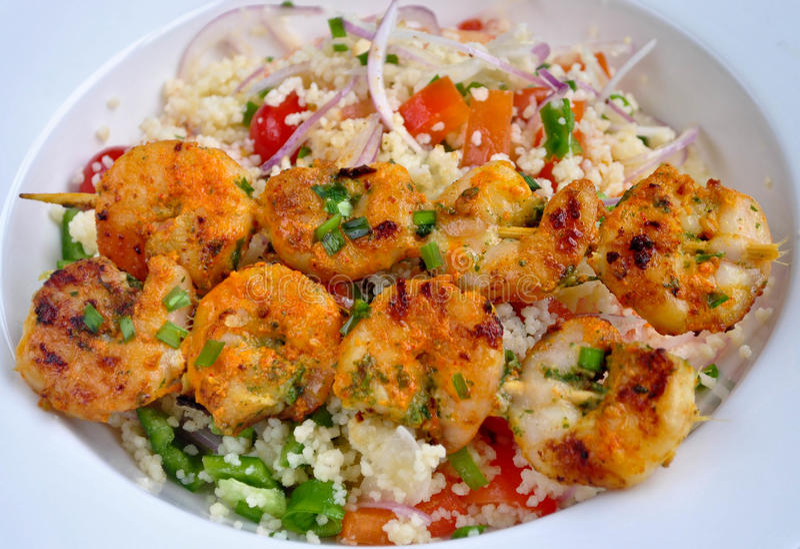 Prawns with Couscous Salad. Prawns Tikka tandoori snack with Couscous Salad royalty free stock photography
