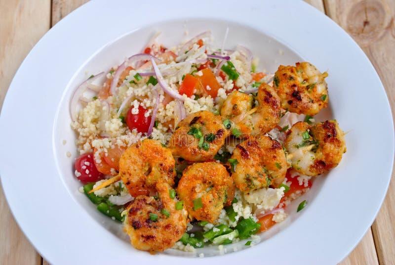 Prawns with Couscous Salad. Prawns Tikka tandoori snack with Couscous Salad stock images