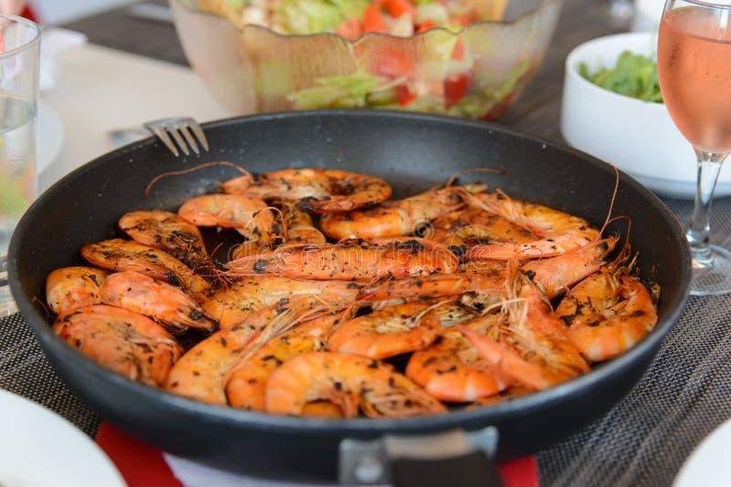 Prawns on hot pan. Giant prawns on hot pan stock photo
