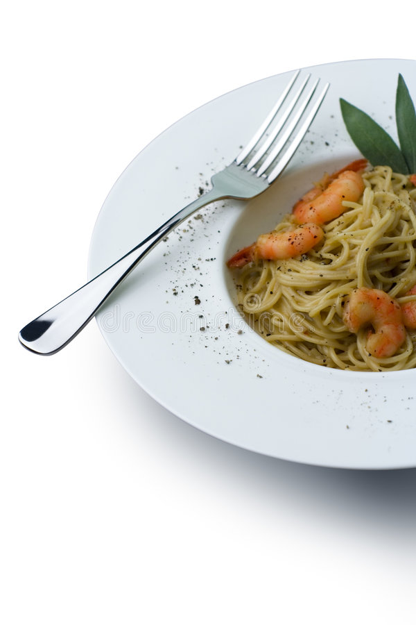 Prawns and Pasta series; clipping path. Spaghetti and prawns in a cream sauce, garnished with herbs. Served on a deep white, round bowl with wide rim sprinkled stock photos