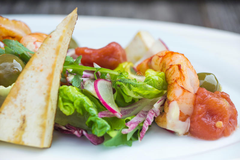 Prawns salad on a wooden background royalty free stock photo