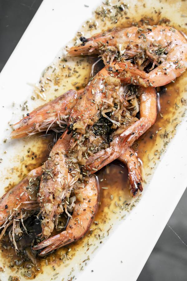 Prawns sauteed with garlic herb and balsamic vinegar sauce royalty free stock image