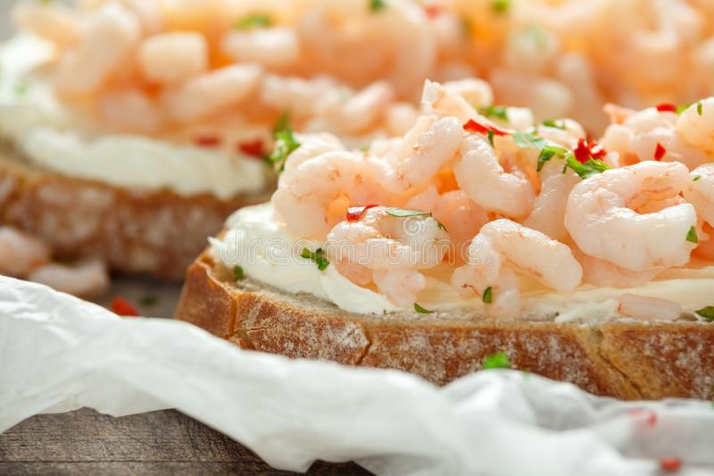 Prawns, shrimp seafood bruschetta with creamy cheese, parsley and chili stock image