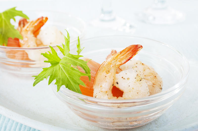 Prawns Shrimp Smoked Salmon Mizuna Appetiser. Dainty appetiser of smoked salmon, prawns and mizuna leaf. Luscious light first course for a special meal royalty free stock images