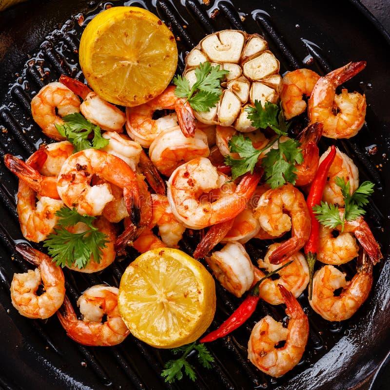 Prawns Shrimps roasted on frying pan close up stock image