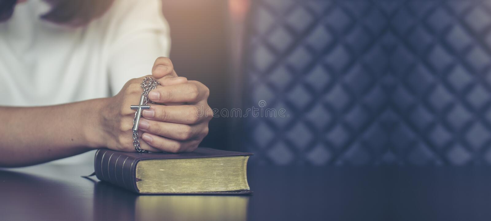 Pray concept. Asian woman praying,hope for peace and free from coronavirus,Hand in hand together by female ,believes and faith in christian religion at church stock photos
