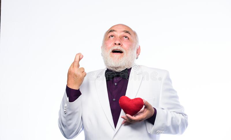 Pray for love. love and romance. valentines day. donor transplant. happy mature man hold red heart. bearded businessman stock images