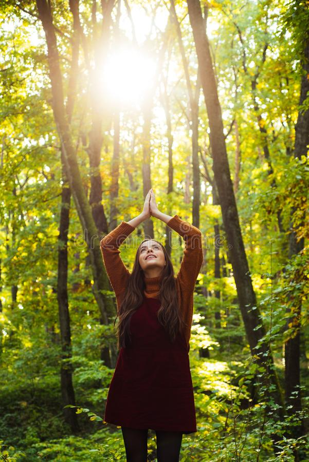 Pray mother nature. Woman enjoy nature alone. Nature is source of power for her. Natural beauty. Autumnal melancholy stock image