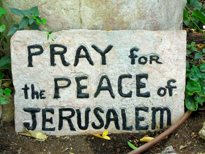 Pray for the Peace of Jerusaelm. Stone painted sign in Israel stock photo