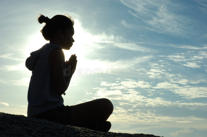 Prayer. At sunrise... a girl sits and prays