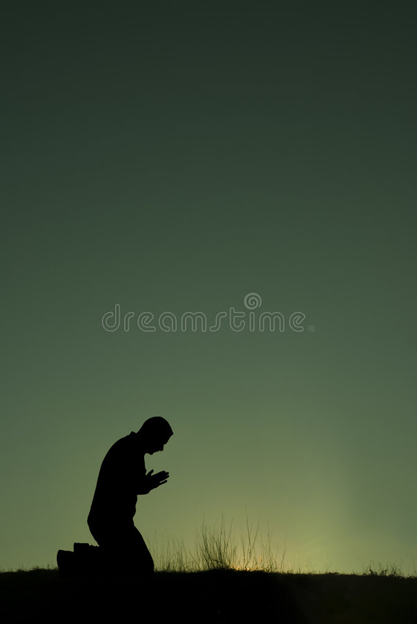 The prayer. A man makes his morning prayer