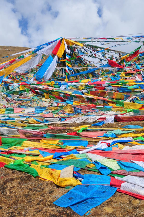 Prayer Banners at Tibet. Prayer put the banners at the stone to pray for peace royalty free stock images