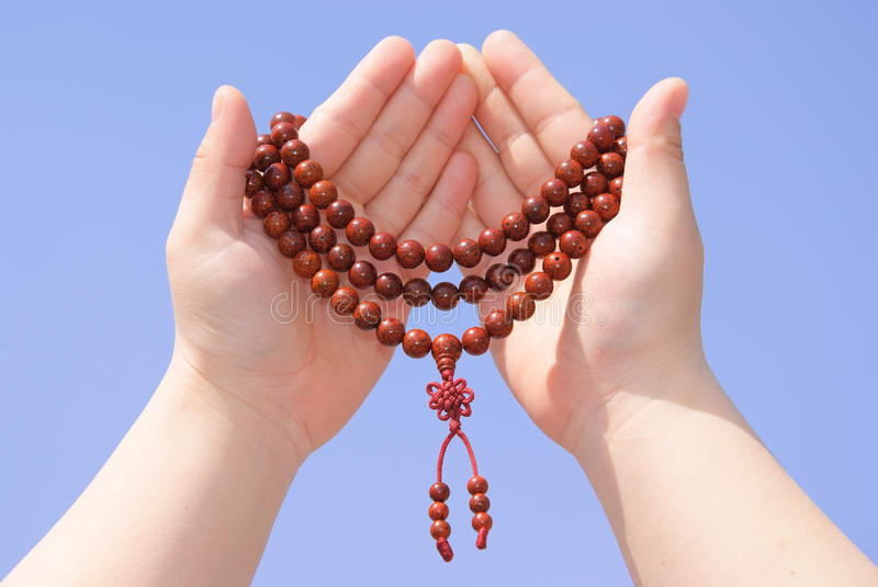 Download Prayer beads in her hands stock image. Image of religion - 14226593