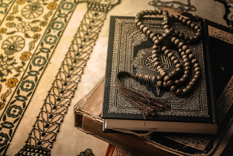 Prayer beads on Koran holy book of Muslims.  royalty free stock photo