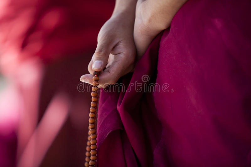 Prayer beads in monk's hand stock photography