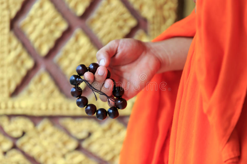 Prayer beads in monk's hand stock photo