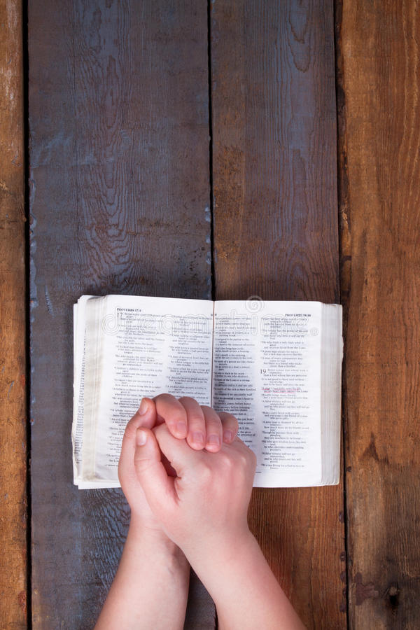 The prayer on the Bible. stock image