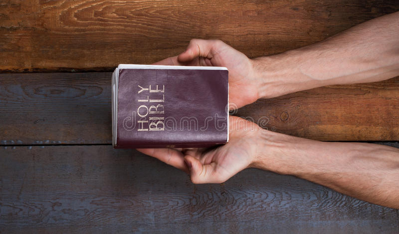 The prayer on the Bible. royalty free stock photography