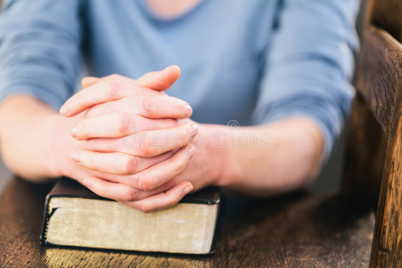 Prayer and a Bible royalty free stock photo