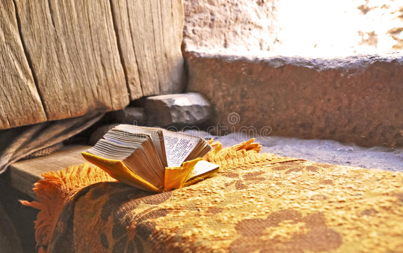 Prayer book in Lalibela. Open prayerbook in a Lalibela rock-hewn church royalty free stock images