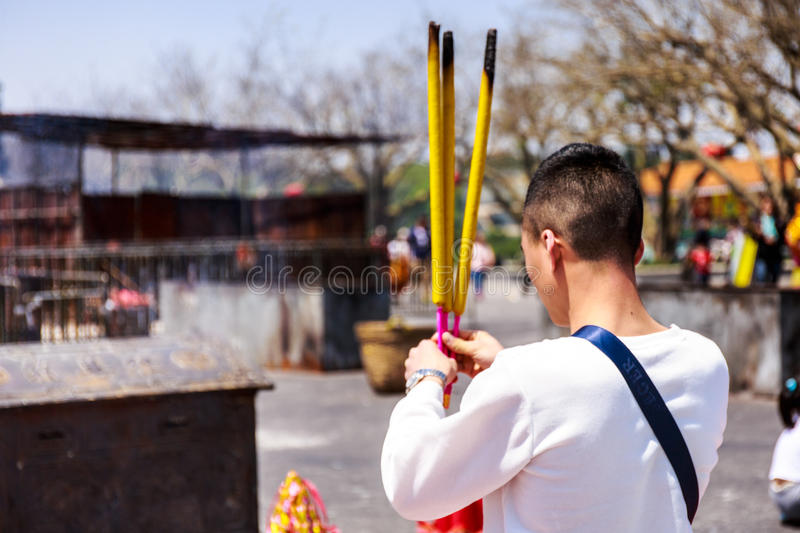 Prayer burning incense and wish good luck stock image