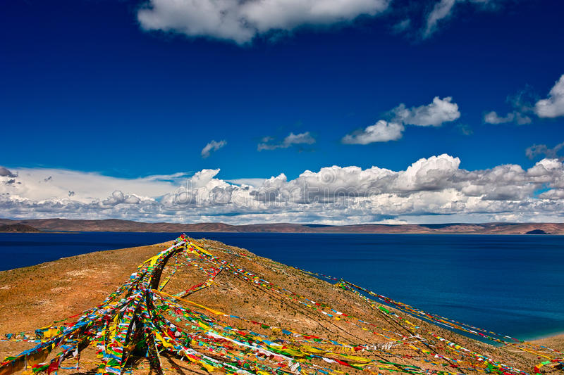 Prayer flags. Flying on the mountain stock photo