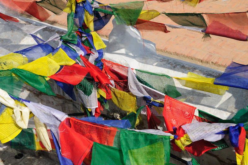 Prayer flags at the Buddhist stupa of Boudhanath royalty free stock photo