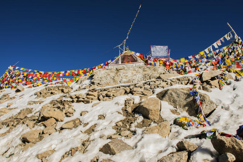Prayer flags at Chang La Pass, the third highest driveable mountain pass in the world 5300m. above sea level, Ladakh, jammu &. Kashmir, India royalty free stock photos