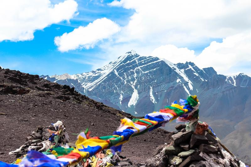 Prayer flags fluttering in the wind on top of a mountain royalty free stock images