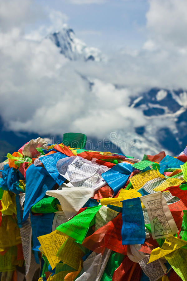 Prayer flags with meili snow mountain in back stock images