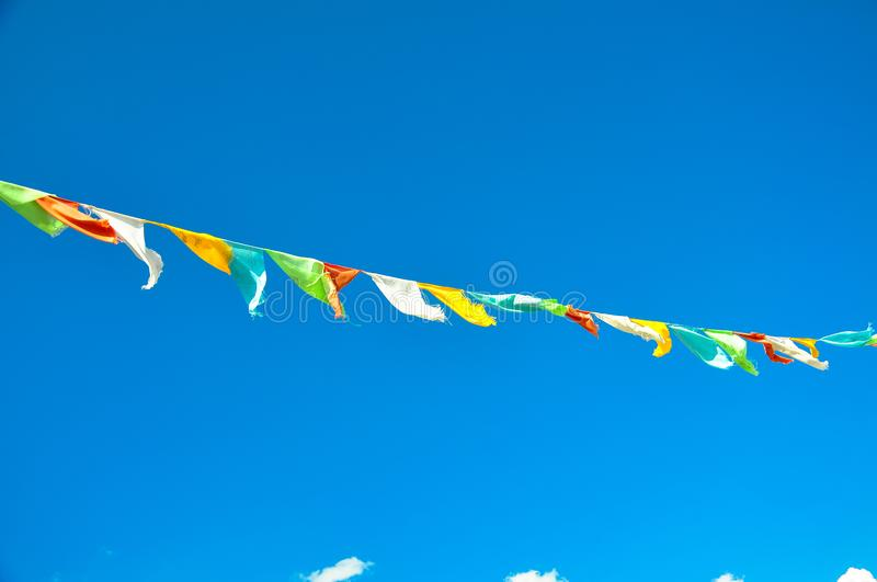 Prayer flags. With blue sky royalty free stock photo
