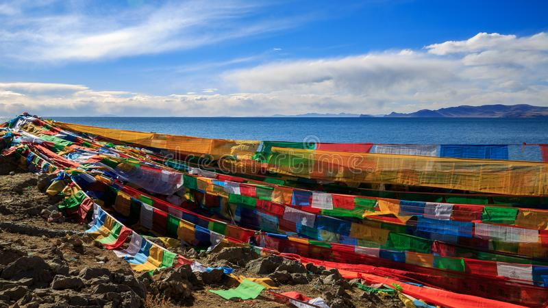 Prayer flags. The Prayer flags on the side of the Lake Nam  of Tibet royalty free stock photography