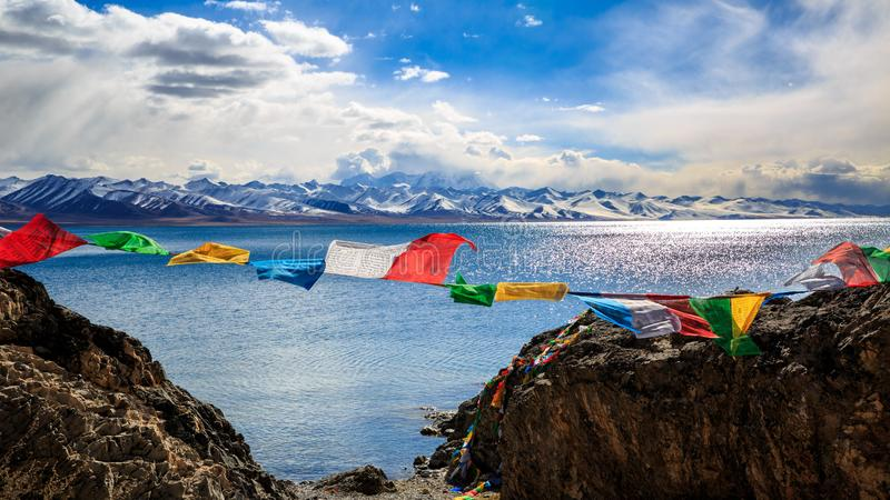 Prayer flags. The Prayer flags on the side of the Lake Nam  of Tibet royalty free stock photos