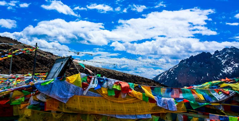 Prayer flags. The Prayer flags on the side of the road royalty free stock photography