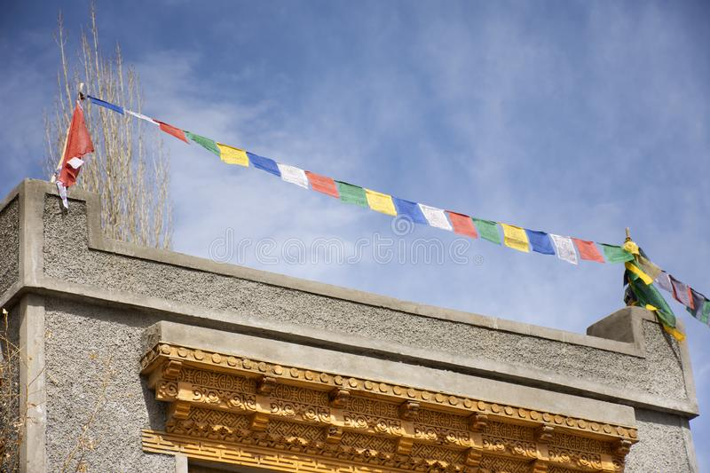 Prayer flags on roof of house at Leh Ladakh village at Himalayan valley in Jammu and Kashmir, India stock images