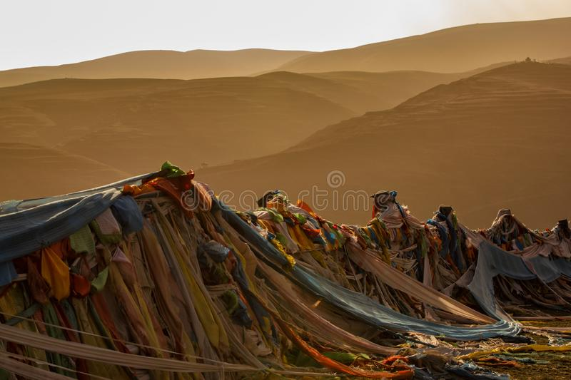 Prayer flags rows, with beautiful mountains in sunset time background royalty free stock photos