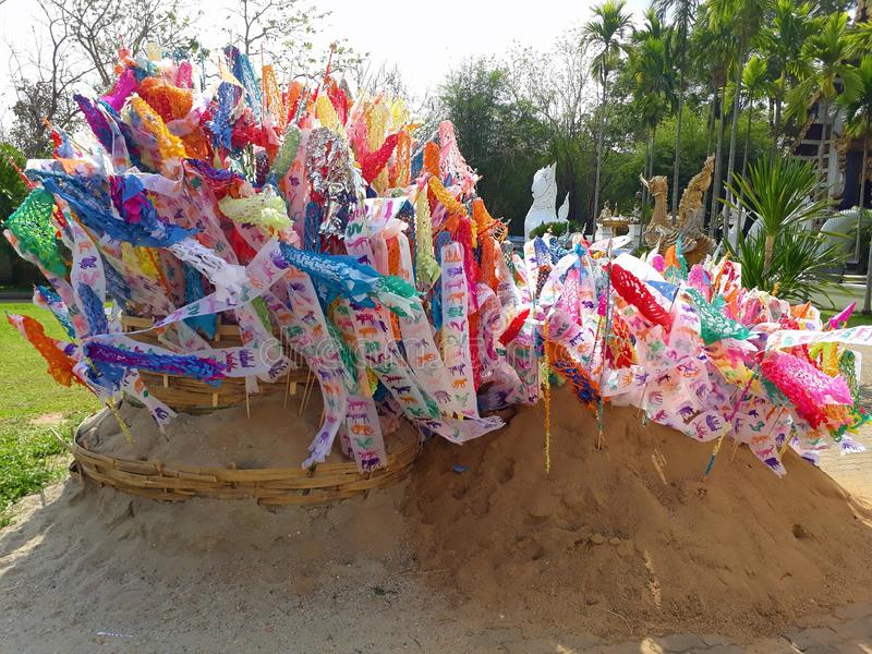 Prayer flags on sand pagoda at temple in songkran festival. Prayer flags on sand pagoda at temple in songkran festival, Chiangmai. Thailand stock image