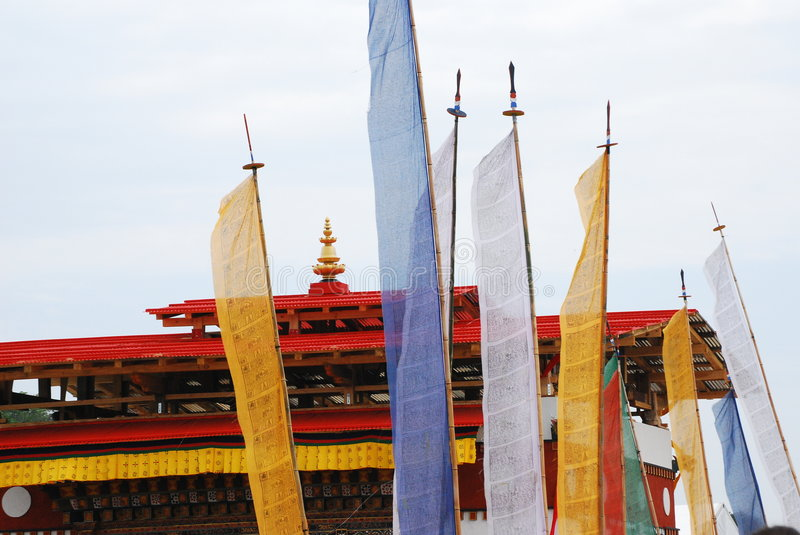 Prayer Flags and Temple. Prayer flags dominate the foreground of the image with a Buddhist pagoda (temple) in the background at the 42nd Annual Smithsonian royalty free stock photo