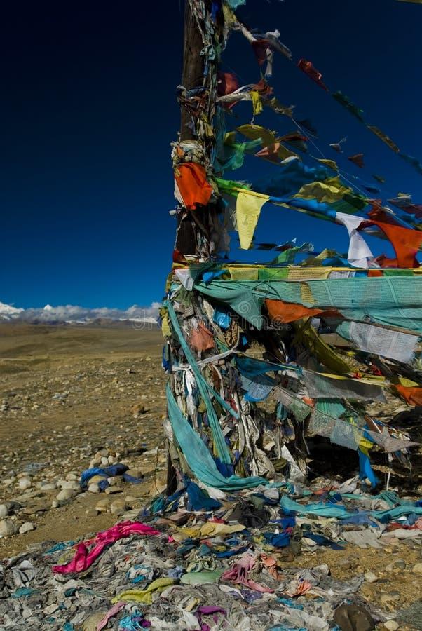Prayer flags in Tibet. Tibetan prayer flags flying at lalung La Pass in Tibet stock images