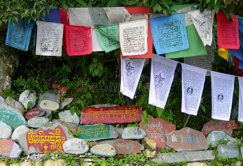 Prayer flags and Tibetan Aum symbols royalty free stock image