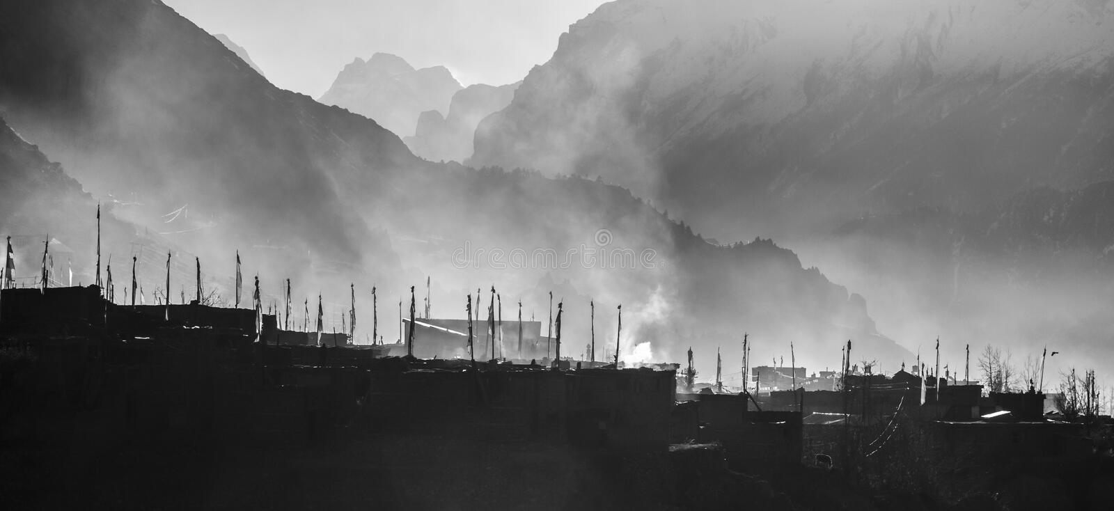 Prayer flags in village Manang. Foggy morning, Nepal, Himalaya, Annapurna conservation area stock image